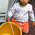Girl with a bucket